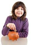 Girl saving money Royalty Free Stock Photography