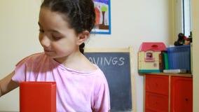 Girl saving money stock video