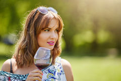 Girl savouring red wine Royalty Free Stock Photos