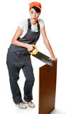 Girl sawing board Stock Images