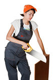 Girl sawing board Royalty Free Stock Image