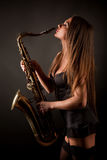 Girl with sax Stock Image