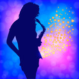 Girl and sax in shine Stock Photo