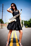 Girl with Sax in Street Royalty Free Stock Images