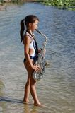 Girl with saxophone Royalty Free Stock Photos