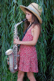 Girl with saxophone Royalty Free Stock Images