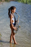 Girl with saxophone Stock Image