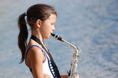 Girl with saxophone Stock Photos