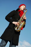 Girl with saxophone Royalty Free Stock Photography
