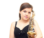 Girl with a saxophone. In a black dress isolated on white background Royalty Free Stock Images