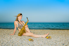 Girl saxophonist Royalty Free Stock Images