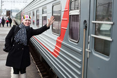 Girl says goodbye on rail platform Stock Photography