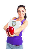 Girl with scales and apple Royalty Free Stock Image