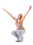 Girl on scales celebrating weightloss Royalty Free Stock Photography
