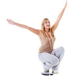 Girl on scales celebrating weightloss Stock Image