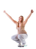 Girl on scales celebrating weightloss Royalty Free Stock Photo