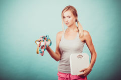 Girl with scales measuring tapes. Weight loss. Stock Photo