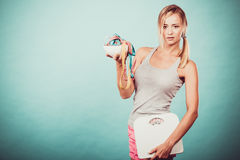 Girl with scales measuring tapes. Weight loss. Stock Images