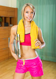 Girl with scales and towel indoor Royalty Free Stock Photos