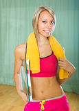 Girl with scales and towel indoor Stock Photos