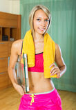Girl with scales and towel indoor Stock Photography