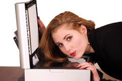 Girl with scanner photocopier. Pretty young woman checking out a scanner photocopier machine Royalty Free Stock Photo