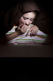 Girl scared in her bed Royalty Free Stock Photo