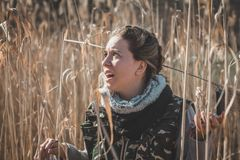 Girl is scared. She is lost in the wild. Girl holding a compass. Compass for better orientation in the nature. Girl is lost in the wild with compass. Girl is stock photos
