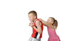 Girl scares boy Royalty Free Stock Photography