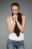 Girl with a scarf. The young woman with a brown scarf on a grey background stock image
