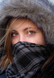 Girl with scarf on face Royalty Free Stock Images