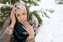 Girl in a scarf and a fashionable winter multi-colored manicure. Next to a pine close-up.Nail art stock photo