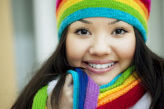 Girl in a scarf and hat of rainbow colors Stock Image