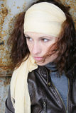 Girl with a scarf on a head. The girl with a yellow scarf on a head stock image