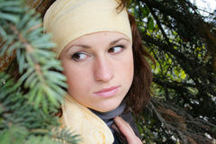 Girl with a scarf on a head. The girl with a yellow scarf on a head royalty free stock images