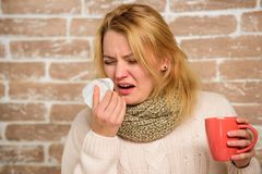 Girl in scarf hold tea mug and tissue. Cold and flu remedies. Runny nose and other symptoms of cold. Remedies should. Help beat cold fast. Tips how to get rid royalty free stock photography