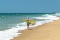 Girl with a scarf and the Indian Ocean royalty free stock photo
