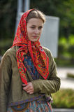 Girl in a scarf and an old Russian costume of the 19th century. Folk festivals (Festival) Slavic Circle, St. Petersburg, Russia stock photos
