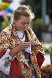 Girl in a scarf and an old Russian costume of the 19th century Royalty Free Stock Image
