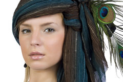 The girl in a scarf with the peacock feathers Stock Image