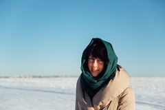 Girl in a scarf on a sunny winter day Royalty Free Stock Photo