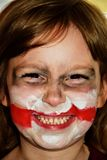 A girl with a scarred face. Face on the style of the joker.  royalty free stock images