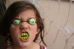 Girl Scary. Girl with creepy eye ball and green teeth Stock Photo