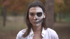 Halloween. Young girl with a scary Halloween makeup. Girl with a scary Halloween makeup. Halloween holiday. All Saints` Night. Halloween concept. Best Halloween stock video