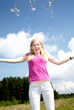 The girl scatters dandelions Royalty Free Stock Photography