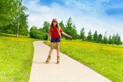 Girl scatting in the park Stock Image