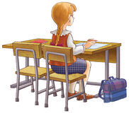 The girl at school. The girl at school sits and writes Stock Photo