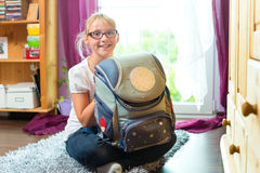 Girl with school bag in her room at home Stock Photography