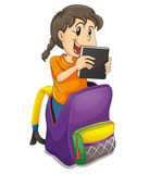 A girl in the school bag Royalty Free Stock Image