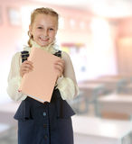 Girl school  in a black dress and  book in his hands. Stock Photos